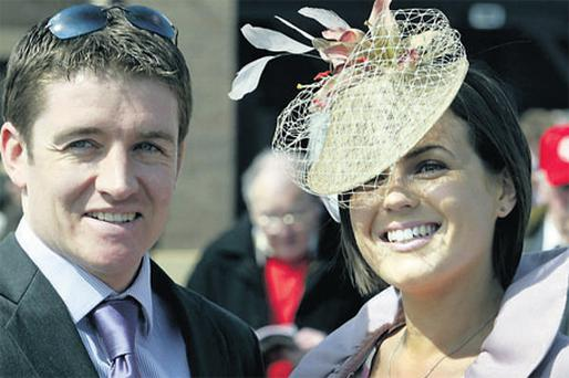 Jockey Barry Geraghty and wife Paula enjoying a day at the races