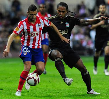 Liverpool's Glen Johnson battles with Athletico Madrid's Simao Sabrosa during their Europa League semi-final first leg. Photo: Getty Images