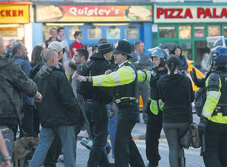 Protesters are halted by police after scuffles broke out with members of the English Defence League in Bristol city centre, close to the Sky studios where the televised leaders' debate was broadcast.