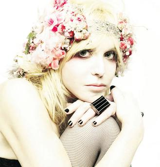 She's rock's most famous widow, but, with a new album out, Courtney Love is finally seeking a little light in her life.