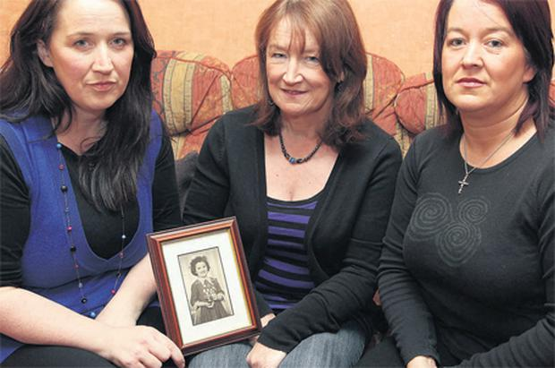 A family's grief: Bernadette Connolly's sisters Kerrie, Ann and Patricia hold a photo of her as a young girl (left). Right: a cross marks the tragic spot near her home; a smiling Bernadette with her mother Maureen