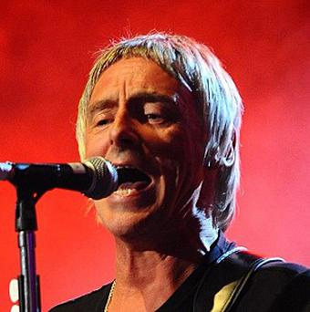 Paul Weller and AC/DC are battling it out for the No 1 spot