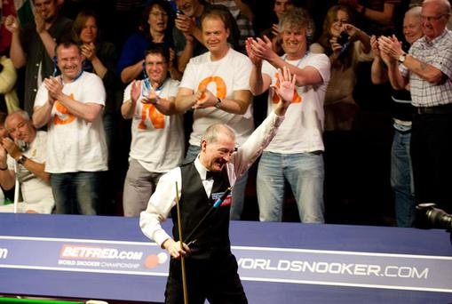 Steve Davis acknowledges the standing ovation after his dramatic victory over defending champion John Higgins in the World Snooker Championship at the Crucible Theatre, Sheffield. Photo: PA