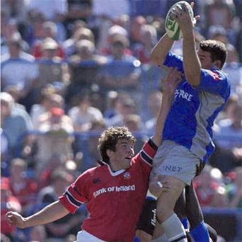 Munster's Donncha O'Callaghan competes with Castres' Nicolas Spanghero, during their 2002 Heineken European Cup semi-final at Stade de la Mediterranie, Beziers. BRENDAN MORAN/SPORTSFILE