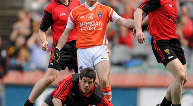 Armagh's Steven McDonnell watches his shot go wide past the Down goalkeeper Brendan McVeigh at Croke Park.