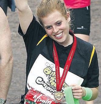 Princess Beatrice cheers after crossing the finish line at yesterday's marathon