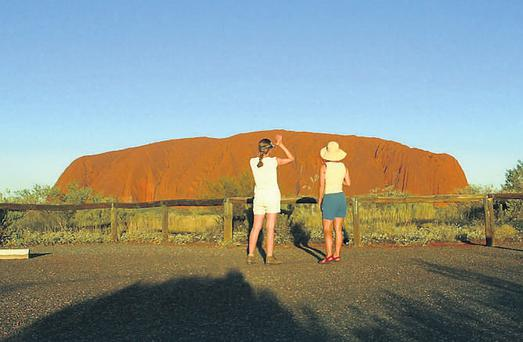 Tourists watch the sun setting on Uluru (Ayers Rock) about 350km southwest of Alice Springs, central Australia