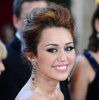 Miley Cyrus is dating her Last Song co-star Liam Hemsworth