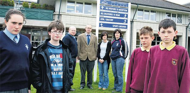 Laura Cottuli of Camolin National School, Jack McCabe of Ballyoughter NS, and Niall Keys and Sean Brady of Castletown NS – with parents Paul Cottuli, Robbie McCabe, Ann Keys and Avril Brady - don't have a place in Gorey Community School