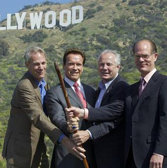 Arnold Schwarzenegger, second left, with leaders from other groups who were battling to save the famous Hollywood sign