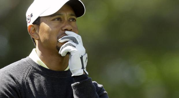 Tiger Woods ponders his options on the 18th fairway during the pro-am for the Quail Hollow Championship yesterday. Photo: AP