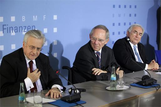 ECB President Jean-Claude Trichet, German Finance Minister Wolfgang Schaeuble, and IMF managing director Dominique Strauss-Kahn at a news conference on financial aid for Greece in Berlin yesterday. Photo: Bloomberg News