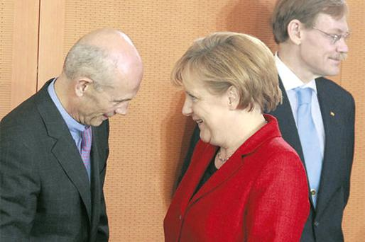 German Chancellor Angela Merkel shakes hands with World Trade Organisation (WTO) Director-General Pascal Lamy (left) as World Bank president Robert Zoellick looks on before a meeting with heads of international trade and financial organisations at the Chancellery in Berlin yesterday