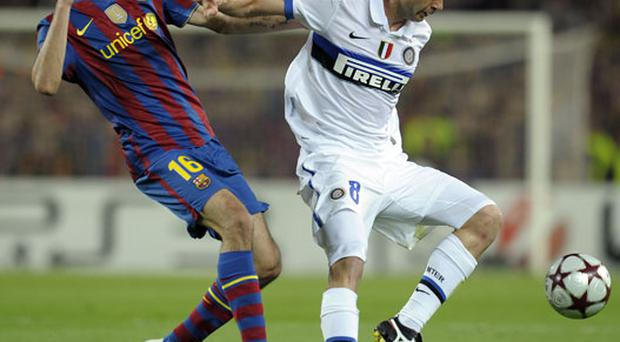 Motta appeared to push Busquets (left) in the neck. Photo: Getty Images
