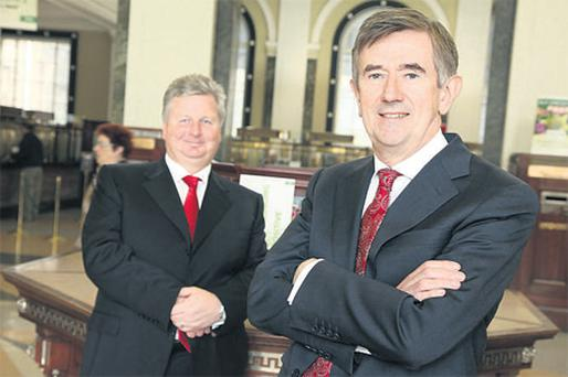 At the announcement of An Post's 2009 results at the GPO yesterday were, from left, chief financial officer Peter Quinn and chief executive Donal Connell