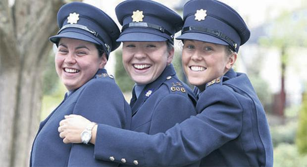 Caoimhe Conway, Niamh Briggs and Essmay Mannix celebrate at yesterday's ceremony