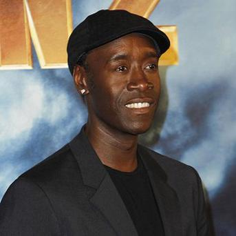Don Cheadle is hoping some Iron Man merchandise comes his way