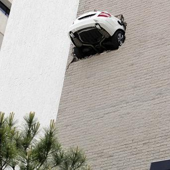A car went through the seventh-floor wall of a parking garage in Oklahoma