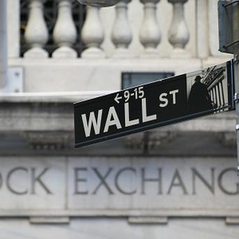A Wall Street sign outside the New York Stock Exchange.