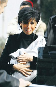 Politician Rachida Dati with her newborn