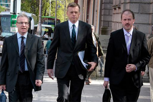 Matthew Elderfield, the Financial Regulator (centre), accompanied by Patrick Brady, assistant director general for risk and policy (left), and Bernard Sheridan, assistant director general for consumer protection