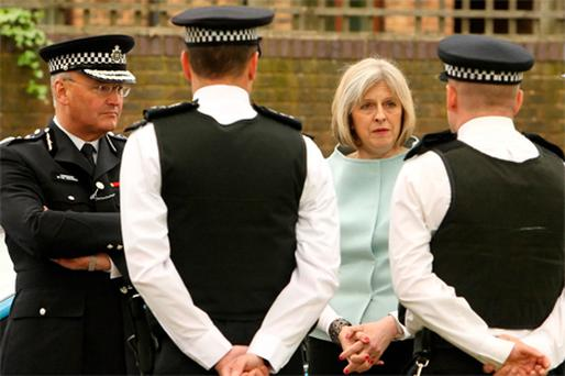 UK Home Secretary Theresa May and Metropolitan Police Commissioner Paul Stephenson meet a neighbourhood policing team during a visit to Clapham, south west London, yesterday