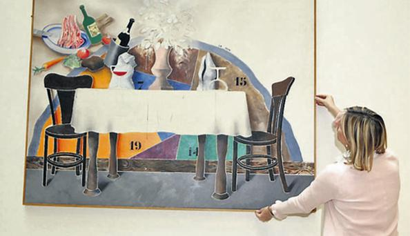 Bank of Ireland's Anne Matthews with a Michael Farrell painting which the bank is selling