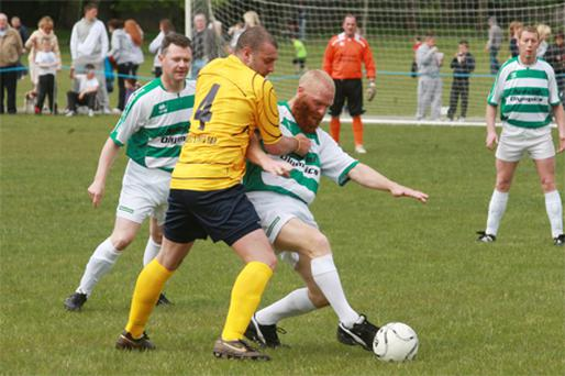 Brother Patrick is tackled by a garda yesterday in the game to raise money for cancer research and Special Olympics