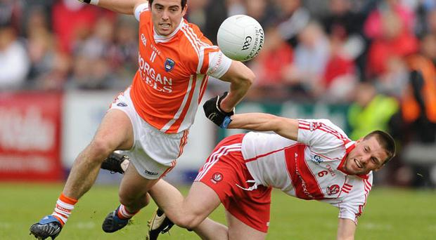 Armagh's Aaron Kernan in action against Barry McGuigan during their Ulster SFC preliminary round clash in Celtic Park. PAUL MOHAN / SPORTSFILE