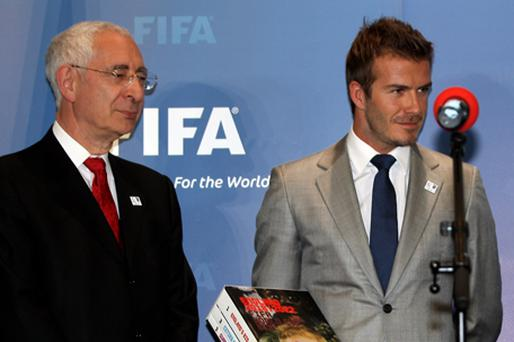 David Beckham,with David Triesman, presents the bid to FIFA. Photo: Getty Images