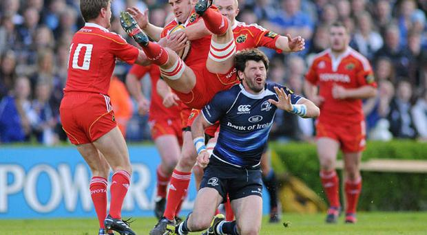 Munster's Niall Ronan lands on top of Leinster's Shane Horgan during Saturday's Magners League semi-final at the RDS. STEPHEN MCCARTHY / SPORTSFILE