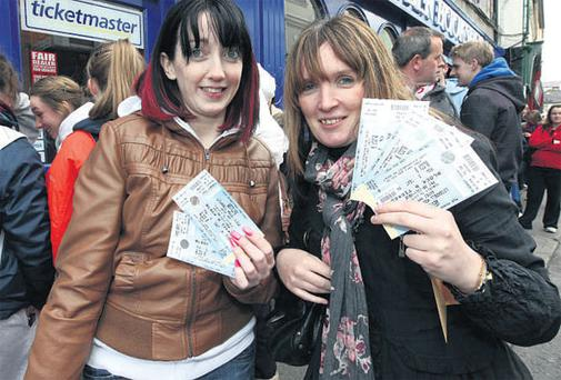 Georgina White and Louise Mitchell, who queued overnight at Third Wave Music in O'Connell Street, Sligo.