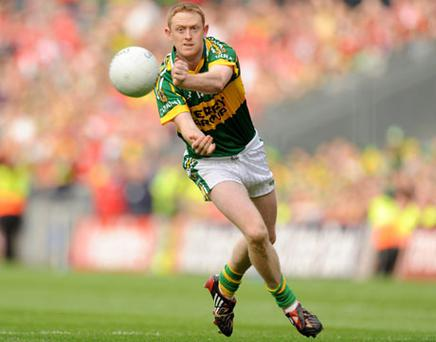 Kerry star Colm Cooper plays a fisted handpass during last year's All-Ireland football final against Cork at Croke Park.