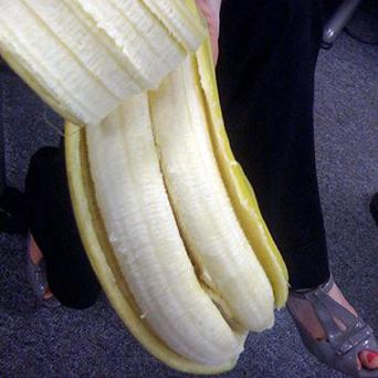 Peeling back its skin, they were stunned to find two bananas inside