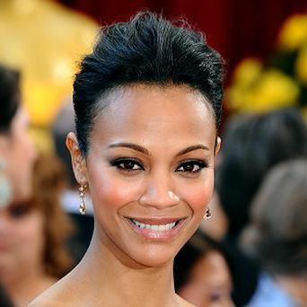 Zoe Saldana is in talks to star as an assassin