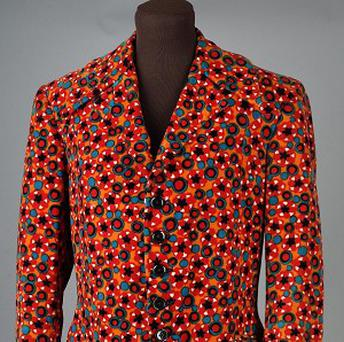 An orange velvet jacket formerly owned by Jimi Hendrix in late 1967