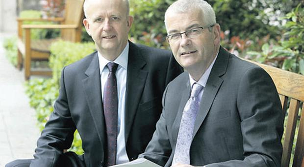 DCC chief executive Tommy Breen (left) and chief financial officer Fergal Dwyer announcing the company's preliminary results in the Four Seasons Hotel, Dublin yesterday