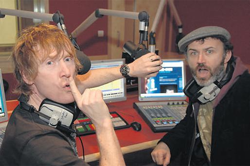 Tommy Tiernan and former classmate Hector O hEochagain in the i102-104 radio studios in Galway. The station now commands a market share of 11.9pc