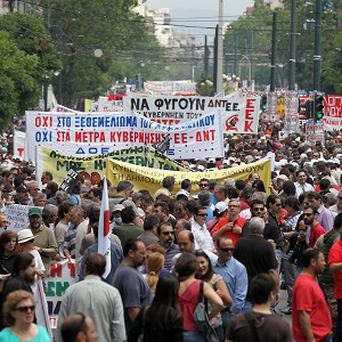 Protesters take part in a rally during a 24-hour strike in Athens