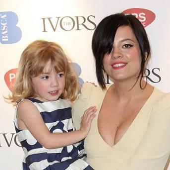Lily Allen and her sister Teddie Rose, 4, arrive at the Ivor Novello Awards in central London