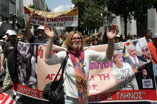 Demonstrators shout slogans as they march in protest on May 20, 2010 in Athens. Photo: Getty Images