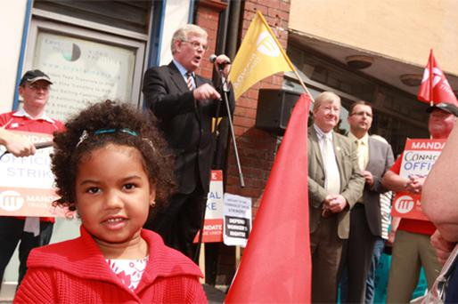 Bia Dica (4) looks on as Labour Party leader Eamon Gilmore speaks at a Mandate rally at Connolly Shoes in Dun Laoghaire