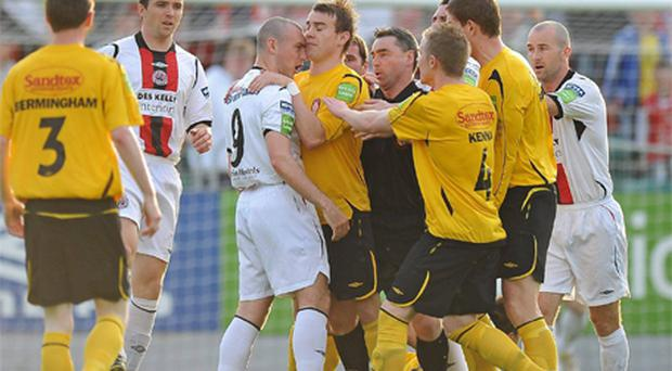 Vinny Faherty of St Patrick's Athletic grabs Mark Quigley, Bohemians, during a heated exchange in their game at Richmond Park last night