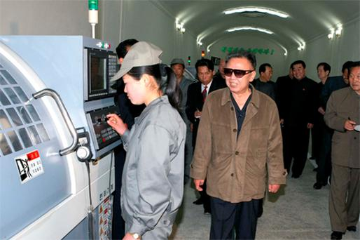 Kim Jong-il visits the Kwanmobong machine-building plant at an undisclosed location in this undated picture released by North Korea's official news agency KCNA yesterday