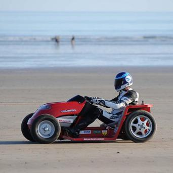 Don Wales during his successful record-breaking run on Pendine Sands in Wales.