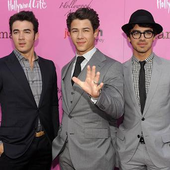 The Jonas Brothers got stuck in a lift after a gig in Hollywood