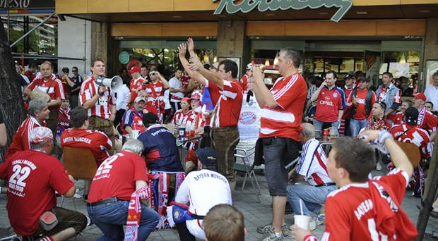 Bayern Fans cheer before the match at the Bernabeau.