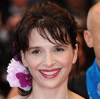 Juliette Binoche said older women should take more risks with their careers