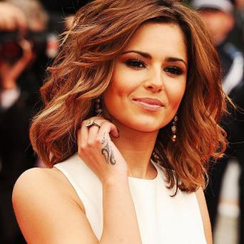 Cheryl Cole dazzled as she arrived at the Cannes Film Festival