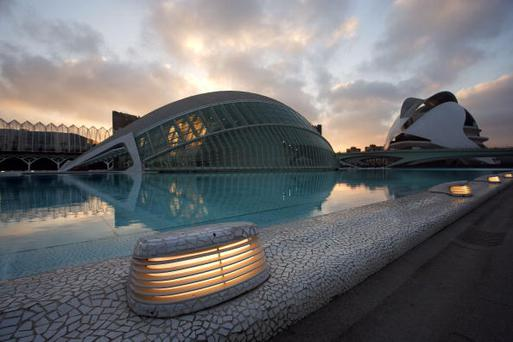 """SPAIN - FEBRUARY 01: """"The Eye of Wisdom"""", The Hemisphere, with The Palau de les Arts (The Arts Palace) in the distance, City of Arts and Sciences ; 1998 ; Santiago Calatrava (Valencia, Spain, 1951) ; Valencia, Comunidad Valenciana, Spain ; First area of the City of Arts and Sciences covering 14,000 square meters. (Photo by Manuel Cohen/Getty Images)"""